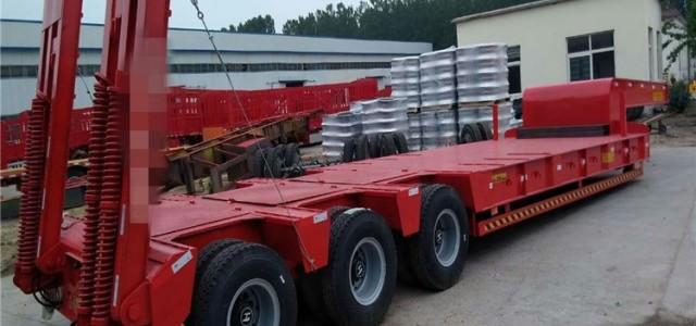 13米低平板半挂车丹江口市_大庆二手低平板挖掘机运输车